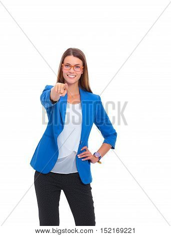 Portrait of a beautiful young woman pointing at you, isolated on white background.