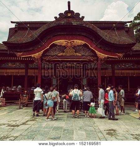 Dazaifu - July 2016: Visitors at Dazaifu Tenmangu Shrine.