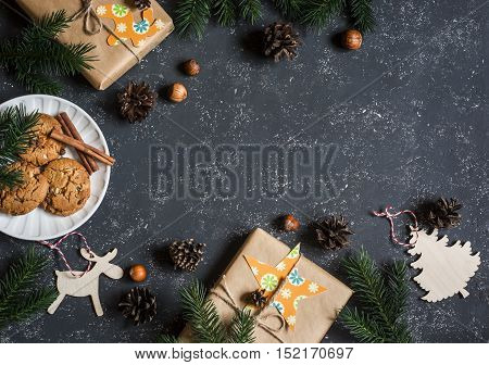 Christmas background. Christmas gifts decorations cookies christmas tree. On a dark background top view. Free space for text. Flat lay