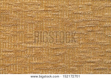Light brown fluffy background of soft fleecy cloth. Texture of textile closeup.