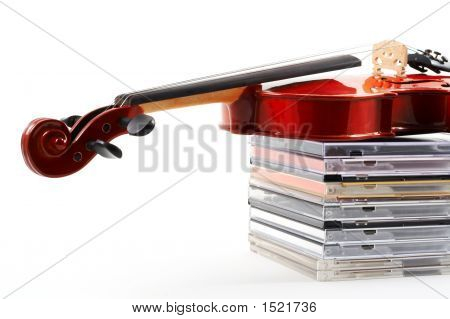 Violin Lying Down On Cds On White Background