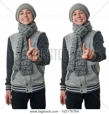 Set of cute teenager boy in gray sweater, hat and scarf pushing something in front himself over white isolated background, half body