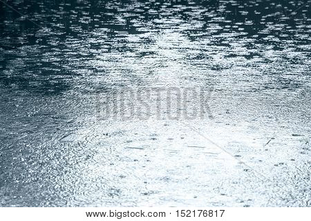City Pavement With Water Puddles During Heavy Rain In Autumn