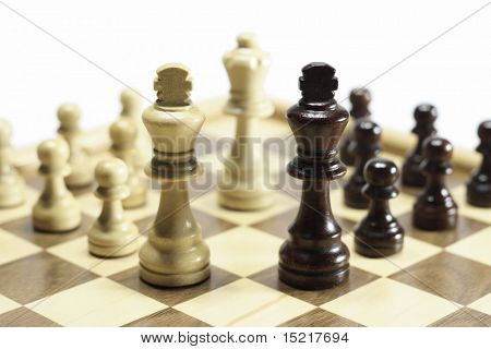 Business concept symmetrical black and white chess pieces unified together.