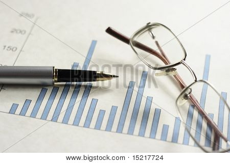 Bar graph pen and glasses.