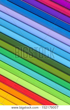 Background of parallel colorful pencils close up