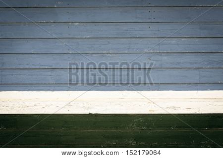 old wooden boards gray and green color texture background and white strip
