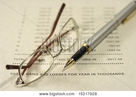 Pen glasses and poor financial figures.