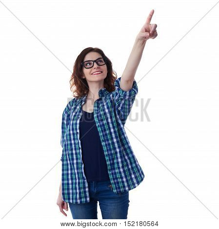 Smiling young woman in casual clothes and glasses over white isolated background pointing, showing direction or pushing button, happy people concept
