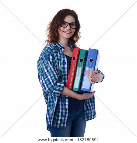 Smiling young woman in casual clothes and glasses over white isolated background with a heap of folders, happy people and lot of work concept