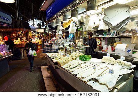 BARCELONA, SPAIN - NOVEMBER 20, 2015: fish for sale at La Boqueria. The Mercat de Sant Josep de la Boqueria is a large public market and one of the city's foremost tourist landmark in Barcelona.