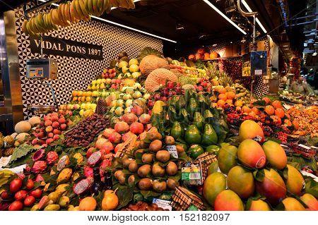 BARCELONA, SPAIN - NOVEMBER 20, 2015: fruits and vegetables for sale at La Boqueria. The Mercat de Sant Josep de la Boqueria is a large public market and tourist landmark in Barcelona.