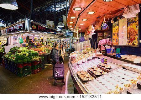 BARCELONA, SPAIN - NOVEMBER 20, 2015: inside La Boqueria in Barcelona. The Mercat de Sant Josep de la Boqueria is a large public market and one of the city's foremost tourist landmark in Barcelona.