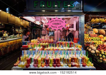 BARCELONA, SPAIN - NOVEMBER 20, 2015: fresh juices at La Boqueria in Barcelona. The Mercat de Sant Josep de la Boqueria is a large public market and tourist landmark in Barcelona.