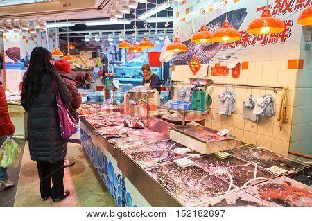 HONG KONG  - 26 JANUARY, 2016: fresh fish stall in Hong Kong. Hong Kong is an autonomous territory on the Pearl River Delta in East Asia.