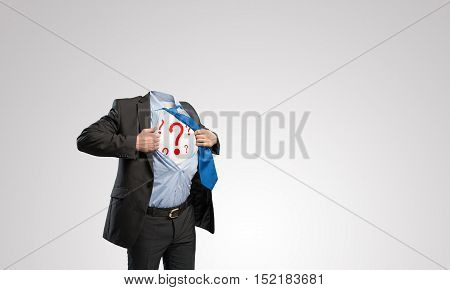 Headless businessman in black suit with question marks acting like super hero