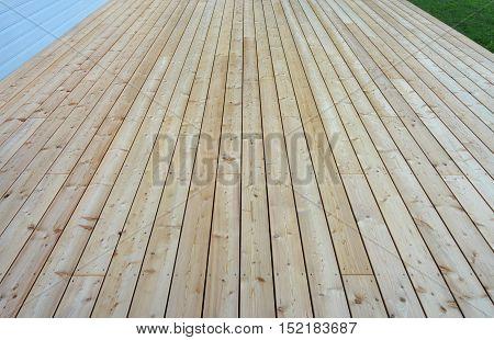 New unpainted terrace floor built of pinetree planks.