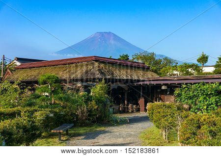Oshino Hakkai Japan countryside landscape of historic thatch roof farmhouses with Mt. Fuji on the background