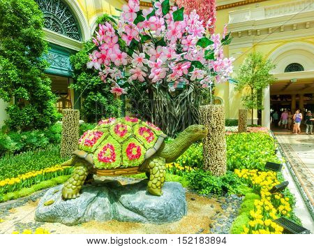 Las Vegas, United States of America - May 05, 2016: The people walking at Japanese flowering garden at luxury hotel Bellagio at Las Vegas, United States of America
