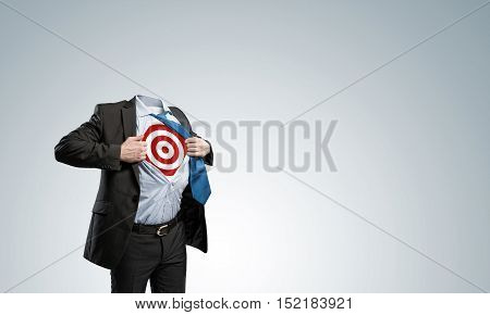 Headless businessman in black suit with target acting like super hero
