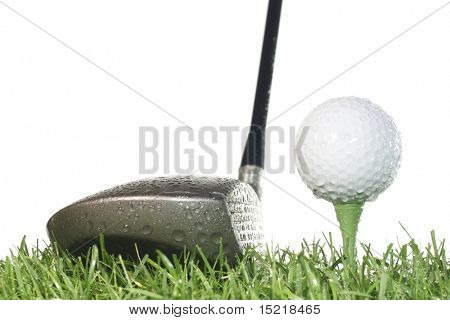 Driver with golf ball on a tee and grass with a white background in damp conditions.