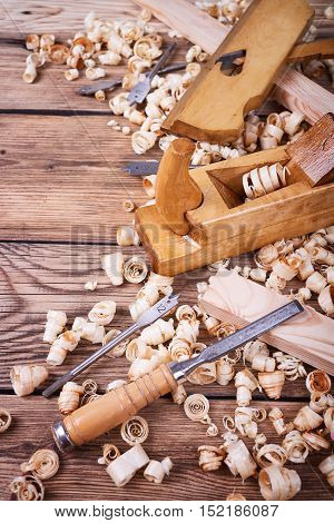 Wooden planer, table from old wood, natural building materials, woodwork and antique hand tools, carrying out carpentry, tool kit for joinery, wood sawdust