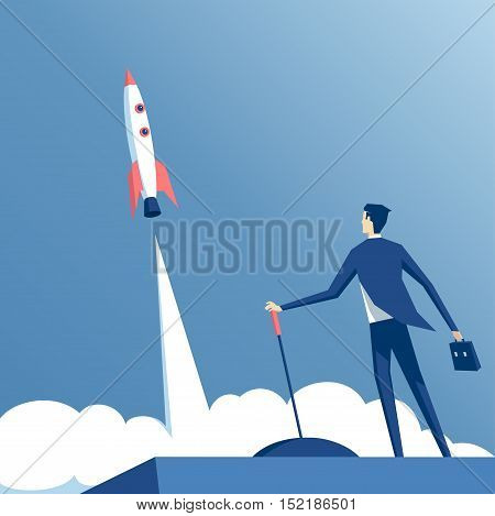 businessman launches rocket into the sky employee performs the start-up of the spacecraft. Business startup concept