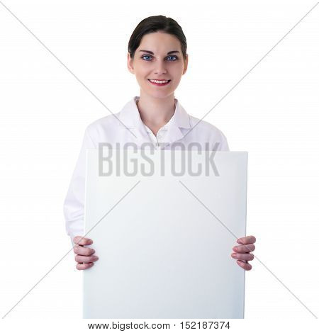 Smiling female doctor assistant scientist in white coat over white isolated background with white blank board, healthcare, profession, science and medicine concept