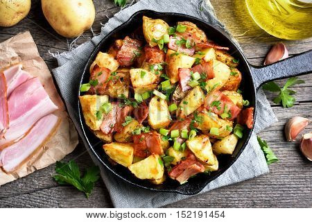 Roasted potato in frying pan top view
