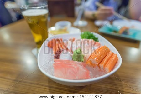 Sashimi in a restaurantJapanese FoodOn a wooden table.