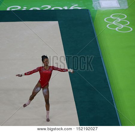 RIO DE JANEIRO, BRAZIL - AUGUST 4, 2016: Olympic champion Gabby Douglas of United States during an artistic gymnastics floor exercise training session for Rio 2016 Olympics at the Rio Olympic Arena