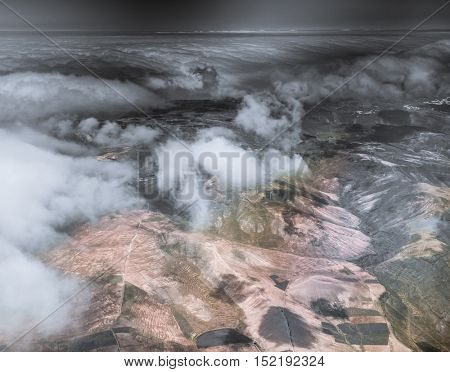 breathtaking aerial view of Lanzarote mountain terrain with clouds from high, Canary Island, Spain