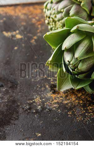 Baby Ripe Organic Artichokes On The Rustic Background