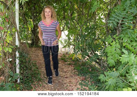 Blond Mature Woman Running And Jogging At Summer