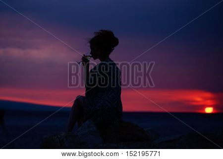Female Silhouette With Wine On Sunset