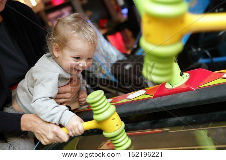 Toddler Playing In Attraction