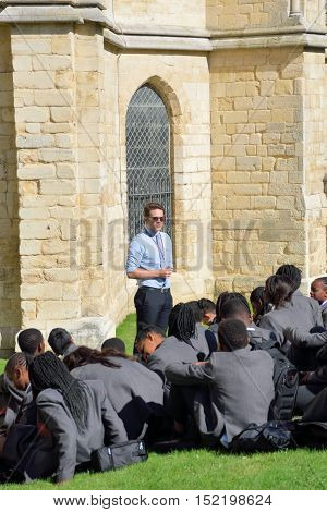 Canterbury United Kingdom - September 30 2016: Cool teacher giving lecture in grounds of Cathedral