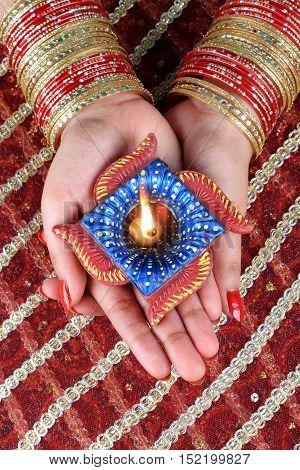 Indian Festival Diwali Diya Lamp Light in Female Hand
