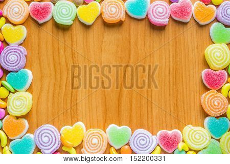 the colorful jelly candies frame for background