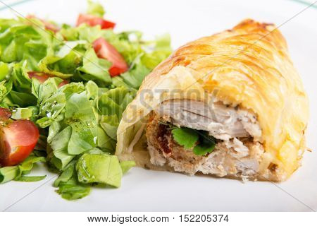 Chicken breast in french pastry with fresh salad