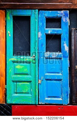 old wooden blue and green doors.photo can be used as background