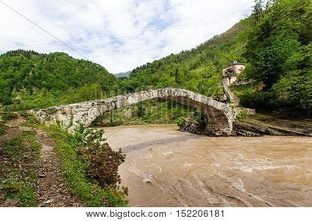 medieval stone bridge over a river in Adjara