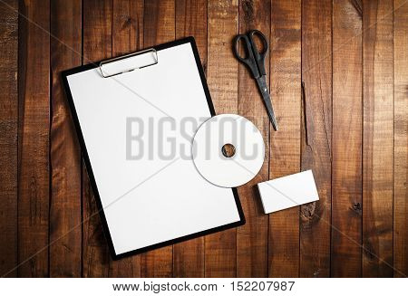 Photo of blank stationery set on wooden table background. ID template. Mock up for branding identity for designers. Mock-up for ID. For design portfolios. Top view.