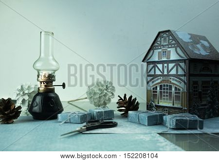 christmas. toy house, pine cones, gifts, kerosene lamp space for text