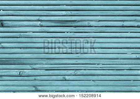 old wooden shafts or corrugated texture of uneven background of blue color