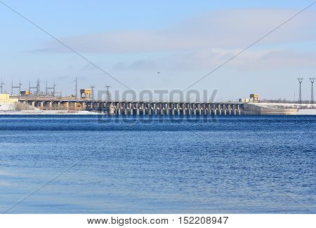 winter landscape with a hydroelectric power station on the river