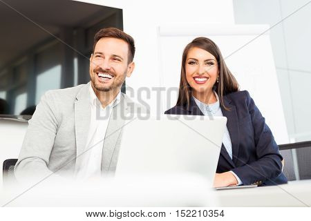 Business couple working together on project at modern office