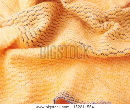 Crumpled yellow towel rag texture as background backdrop