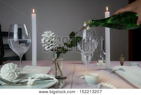 elegant table setting. romantic dinner - a table with a tablecloth, cutlery, candles, flowers, buds