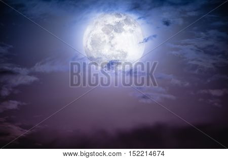 Attractive photo of a nighttime sky with clouds and bright full moon. Nightly sky with beautiful full moon. Outdoors at night. The moon were NOT furnished by NASA.